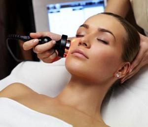 Woman receiving facial skin treatment